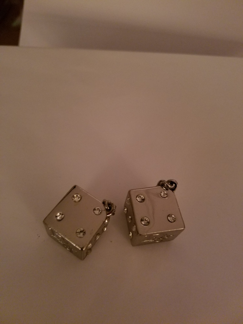 Silver dice charm
